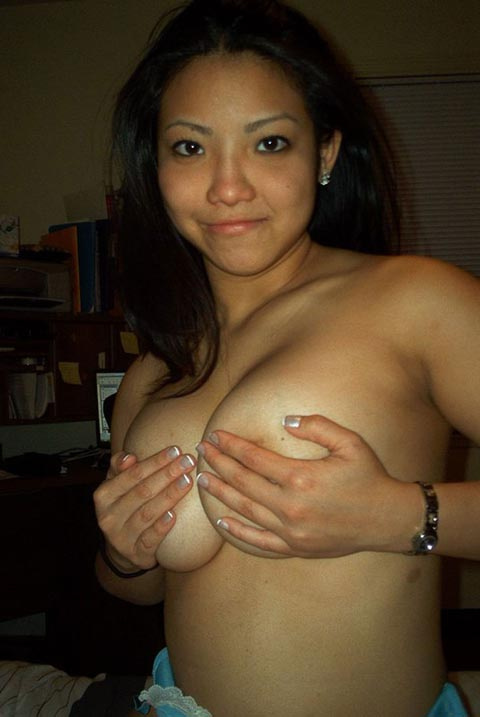 Busty Asian Teen Posing in Bedroom
