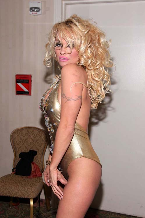Pamela Anderson Whorish Look In Swimsuit At A Fashion Show