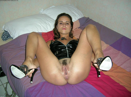 Wife Poses In Black Leather Bondage Outfit