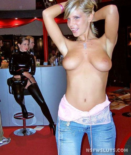 Milf shows tits in bar